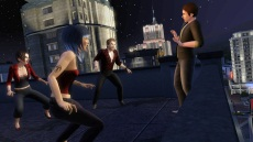 Three vampires force a regular Sim into a corner
